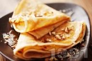 Палачинки с бърза смес (тесто) от кисело мляко, яйца и брашно поднесени с мед и орехи